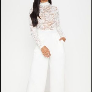 New with tags.Petite White Lace Jumpsuit.UK6 (US2)